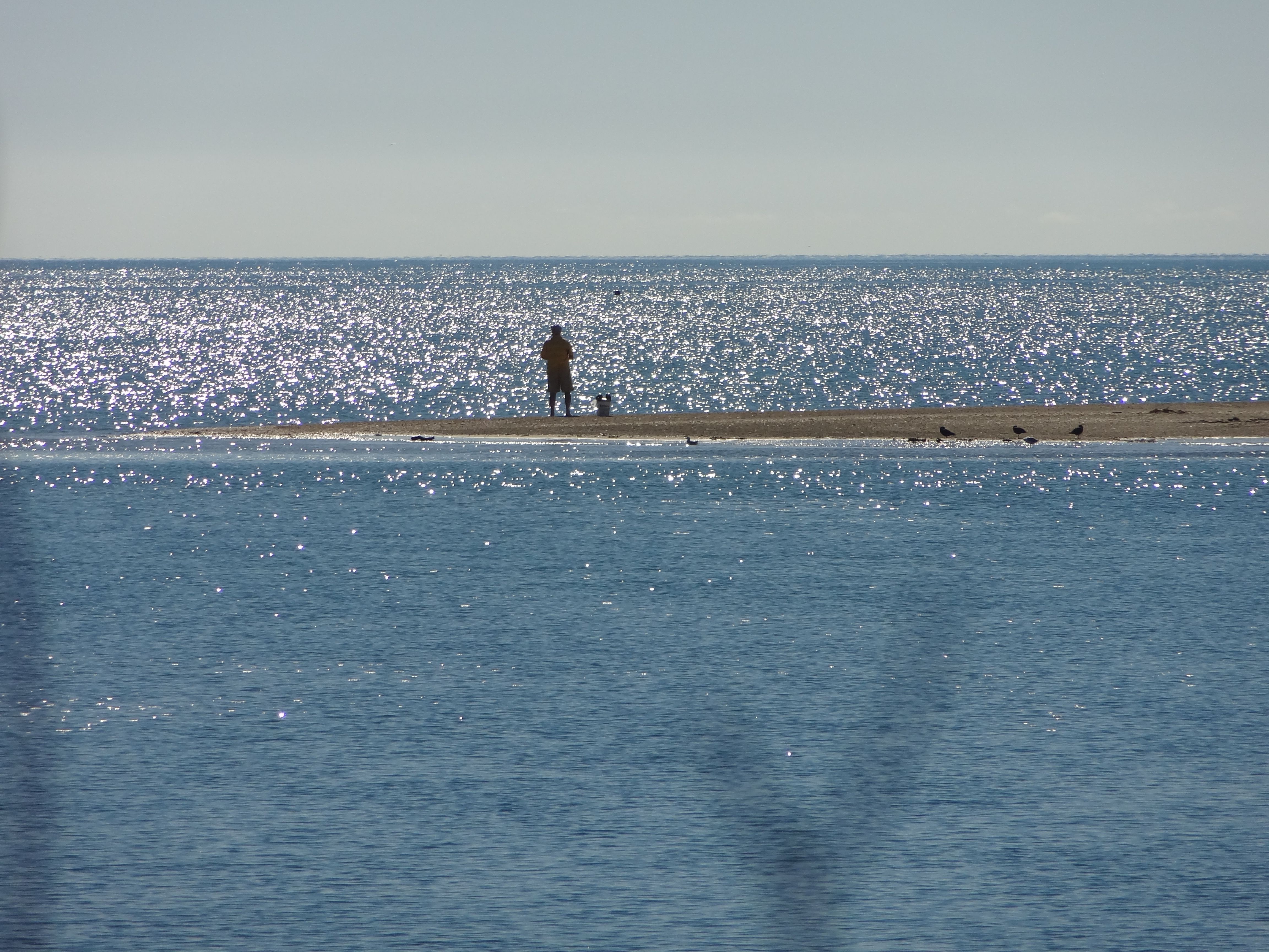 One man and his rod. It isn't difficult to find a beach to yourself here - this is Milnthorpe Quay